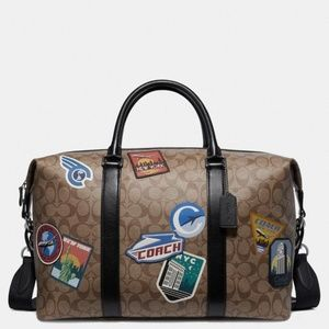 Nwt Coach Voyager Signature with travel patches